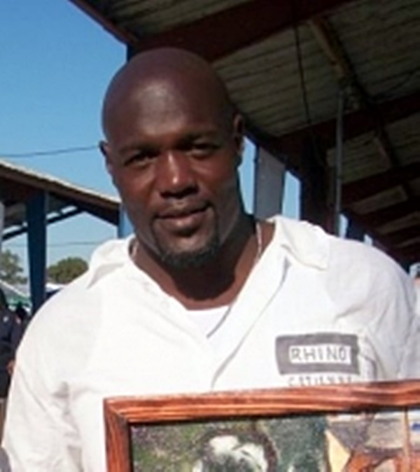 Former Clifford Etienne Cutting Hair and Painting in Prison