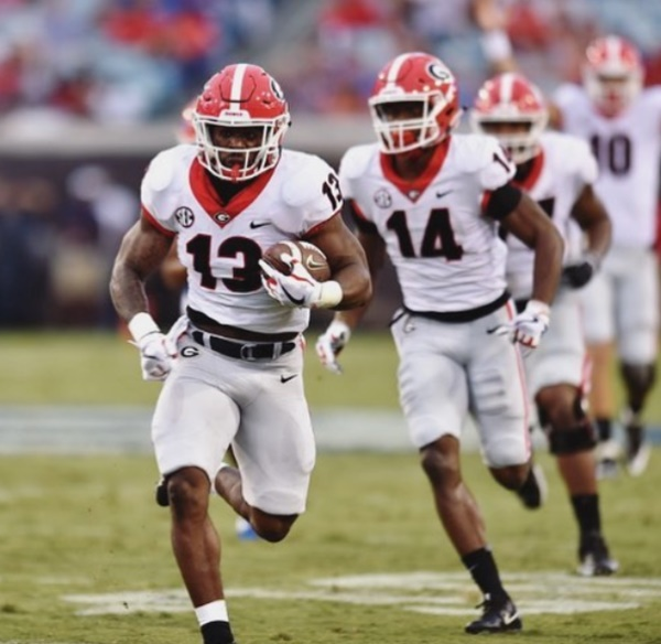 Elijah Holyfield: 10 Mouth-Watering Photos of Georgia's RB Beast